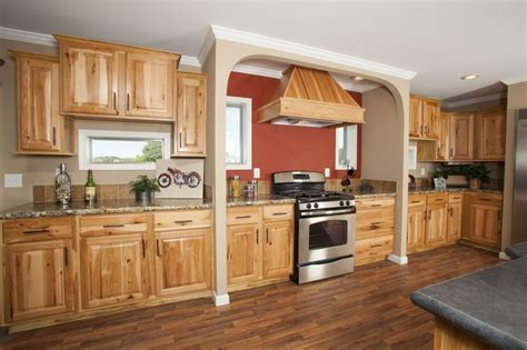 honey spice hickory cupboards   Using orange paint color
