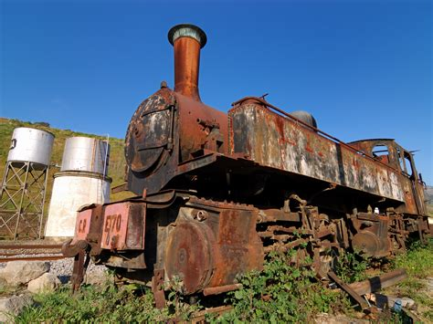 rusty train file rusty steam locomotive in tua train station jpg