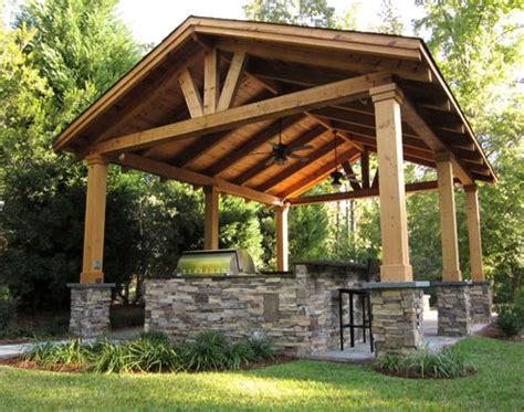 backyard structure pergola with solid roof stone and timber columns garden
