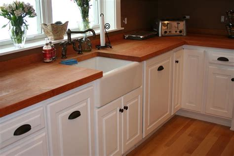 pale yellow walls white cabinets wood counter tops white painted cabinets with those dark and copper knobs