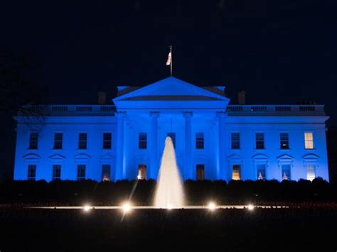 blue and white house white house turns blue for world autism awareness day