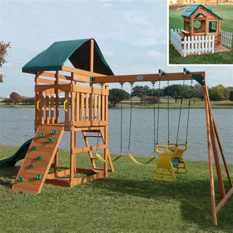 wooden playhouse with swing swing town the phoenix swing set with mayfield cottage