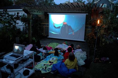 backyard movie night projector bring the movies to your backyard space living outdoors
