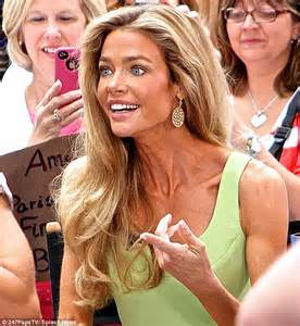 denise richards this morning denise richards displays her muscular calves in lime green
