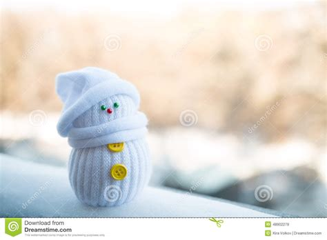 tiny small cute little snowman on a blurry background stock