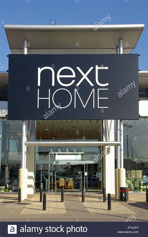next home store sign and canopy entrance at the