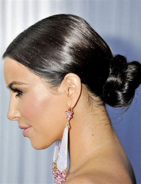 low neck short curly hair kim kardashian wears a slick bun at the nape of her neck