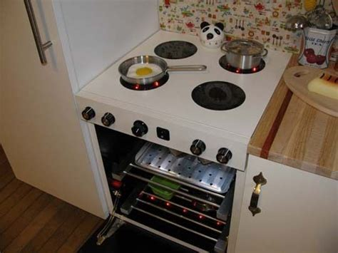 A play kitchen with working stove/oven knobs and lights