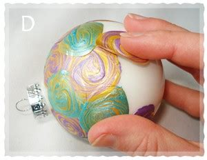 how to make paint swirled ornaments easy gifts to make santa claus and
