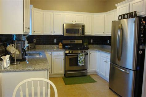 painting dark kitchen cabinets white painting your kitchen cabinets is easy just follow our