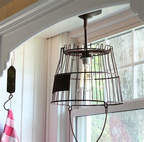 my kitchen s new old light fixture make over thrift 187 how to make a pendant light from an old rusty egg