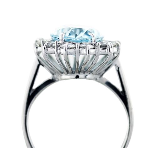 aquamarine and cocktail ring in 14k white gold