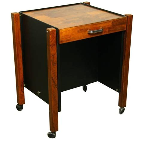 single rolling side table in rosewood by jorge zalszupin