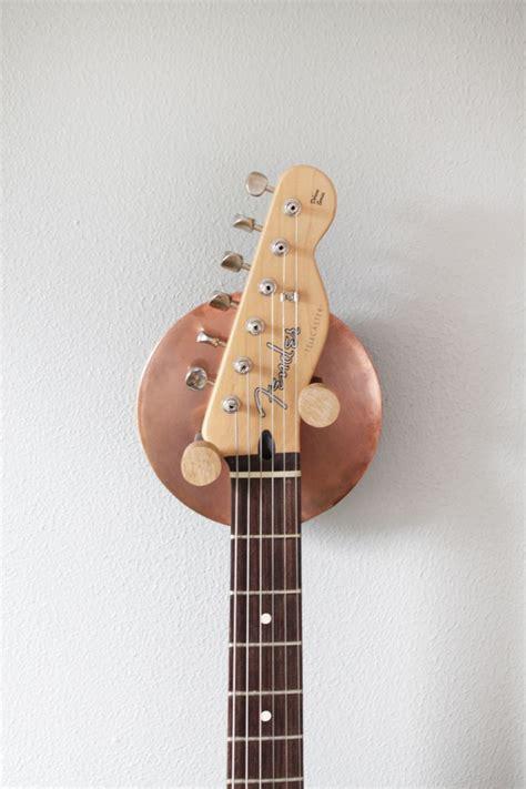 is it ok to hang guitars on wall hyla home living room guitar wall