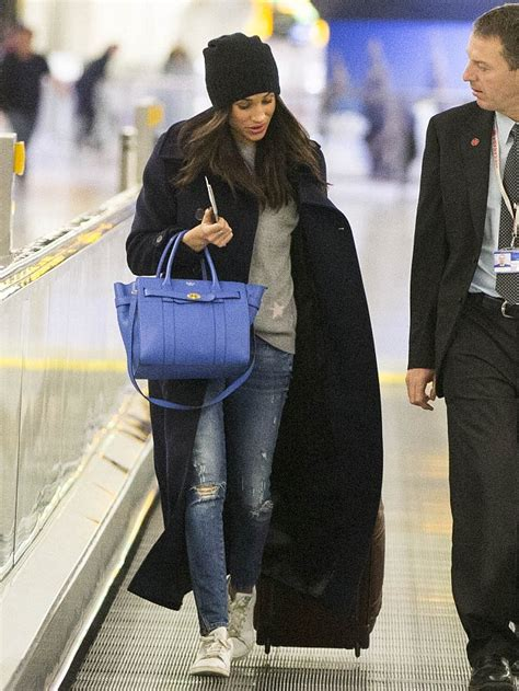 Meghan Markle Toronto by Meghan Markle Is Glued To Her Phone In Toronto After A