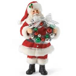 santa holding christmas wreath possible dreams figurine