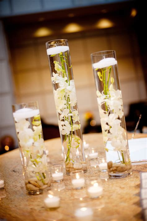 Table Vases For Weddings by Real Wedding With Simple Diy Details Hurricane Vases Floating White Orchids Centerpieces