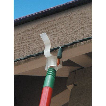 how to hang christmas lights under eaves 25ct eaves for hanging decorations and lights without using a ladder walmart