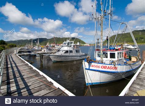 fishing boat nz port with fishing boats and jetty taken in greymouth new