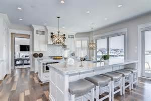 Transitional Kitchen With Double Islands With White Marble Counters