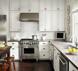 white kitchen cabinets and white countertops a case for concrete counters