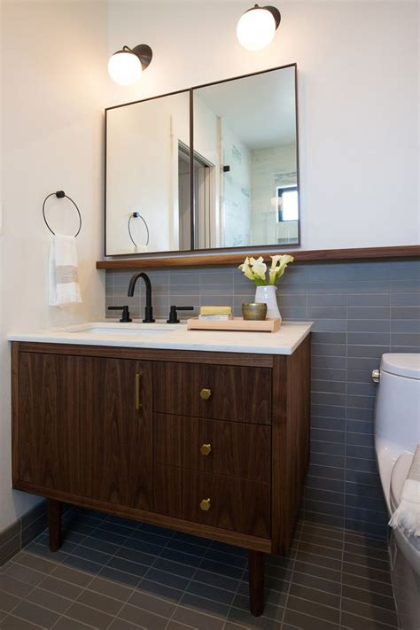 midcentury style vanity matching tile floor wainscot