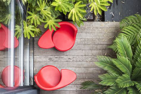 cool patio chairs contemporary villa with splashing colors and courtyard