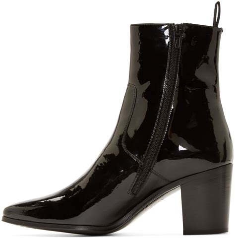 laurent black patent leather boots in black