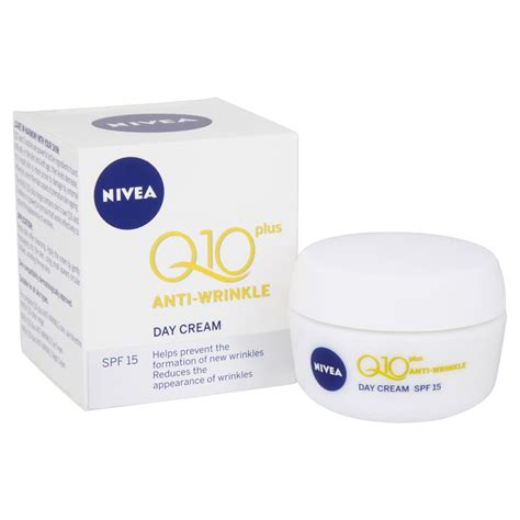 swinging couple with creie and facial nivea q10 plus anti wrinkle day cream spf 15 50ml at wilko com