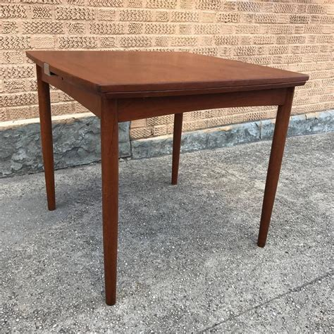 modern dining table with pull out leaves seats ten at 1stdibs kurt ostervig danish modern teak dining set cityfoundry