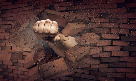 hand breaking through the wall mixed media stock photo