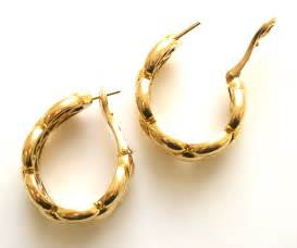 gold ear ring image a pair of gold earrings by cartier klosterman jewelry archives