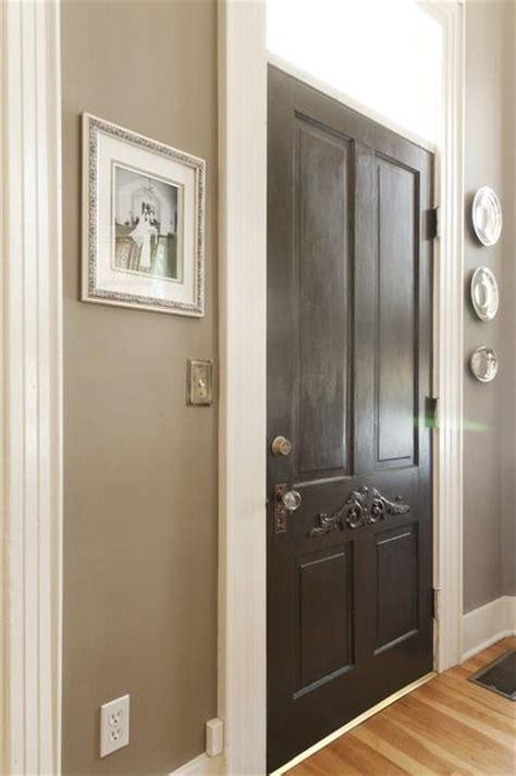white trim with wood floors greige walls white trim black door wood floors paint