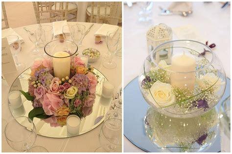 centrotavola matrimonio con candele e fiori centrotavola romantico tema matrimonio specchio fiori
