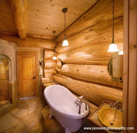 rustic log home bathroom cabin fever pinterest beautiful log walls and a traditional tub courtesy of