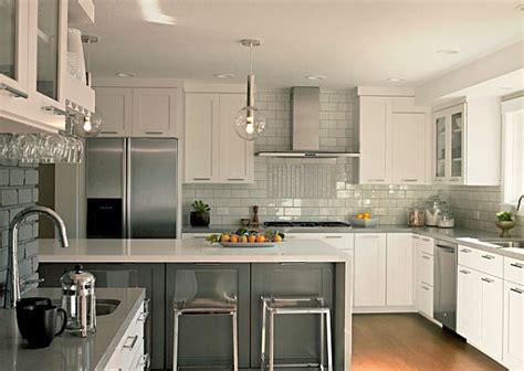 grey and white kitchen furniture with grey backsplash