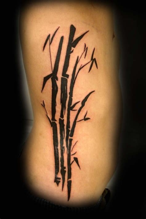 black ink bamboo tattoo on rib side tattooshunt com