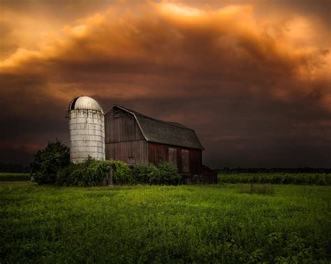Red Barn Light Red Barn Stormy Sky Rustic Dreams Photograph By Gary Heller