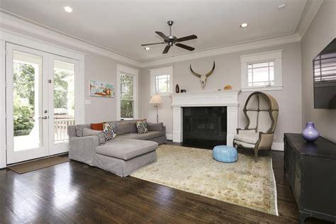 recessed lighting layout living room informal living room that features doors that lead