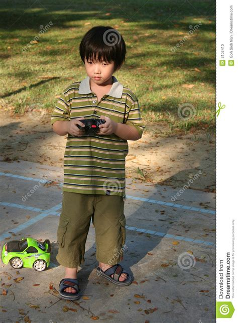 boy playing remote control car stock photo image