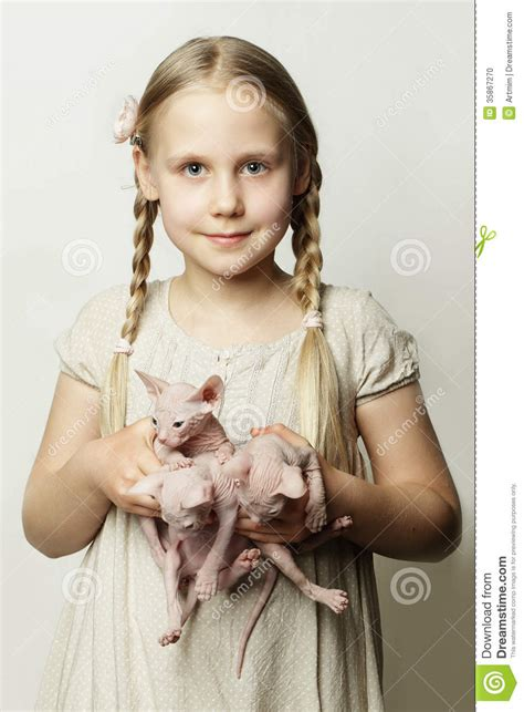 cute child girl with kittens cute child and baby animals stock photo