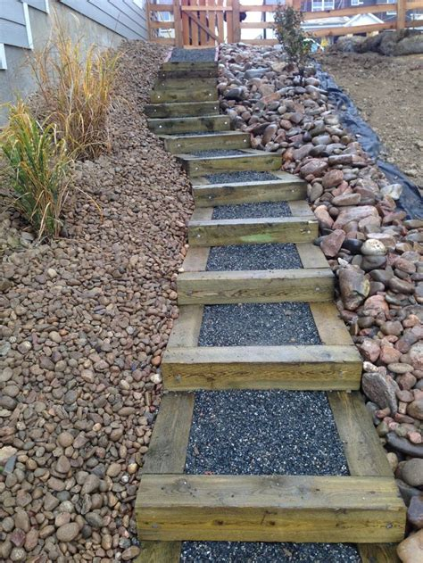 timber stairs on steep slope in new construction site installed by glacier view landscape