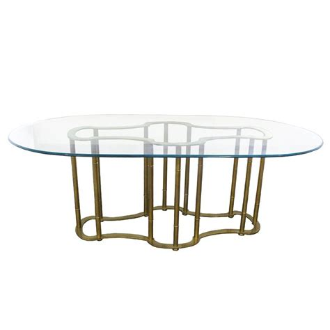 oval glass and brass dining table by mastercraft at 1stdibs
