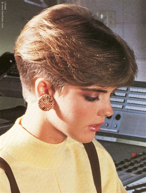 feathered hair into nape of neck short 1980s ladies haircut with a clippered nape