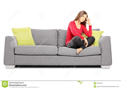 sitting in sofa sad young female sitting on a sofa stock photo image