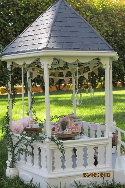miniature gazebo the climbing roses are flowering in my miniature gazebo