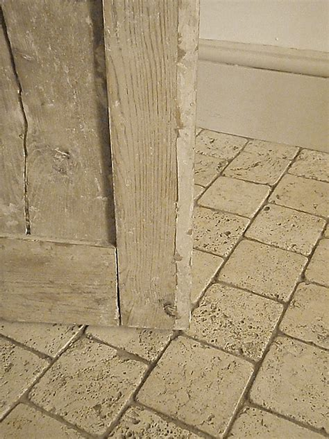 travertine bathroom floor tumbled and filled travertine with grey grout and lime washed wood bathroom floor