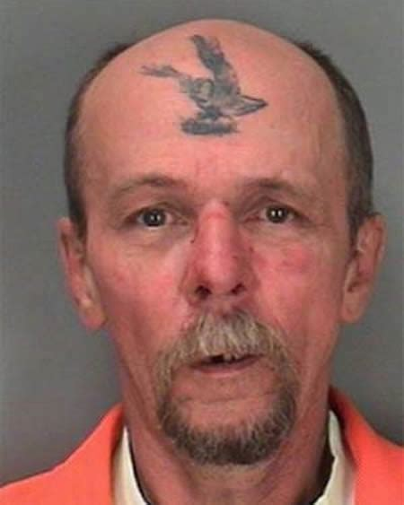 logo tattoo on forehead 15 most stupid forehead tattoos stupid tattoos