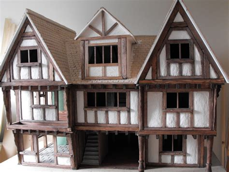 dolls house builder building a tudor dolls house