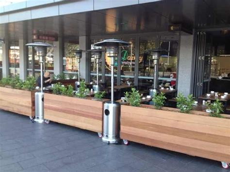 restaurant patio planters smart us of cedar dining barriers and gas heating dainty